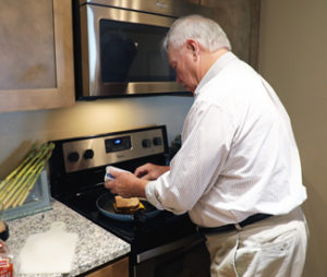 Senior using cooking support